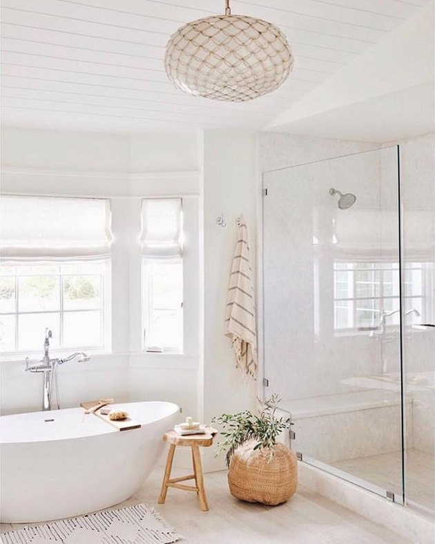 minimal bohemian bathroom lighting idea with capiz shell chandelier