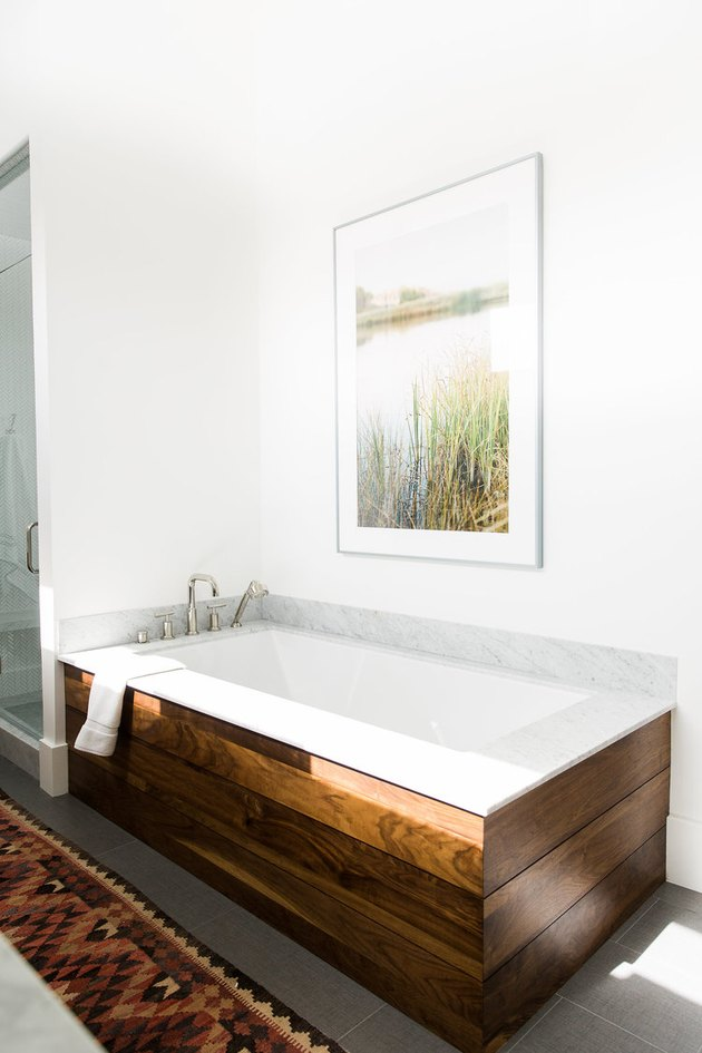 Modern bathroom with drop-in bathtub and wood surround