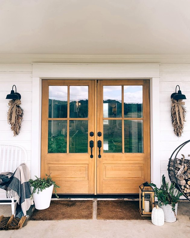 farmhouse fall decor on porch in natural hues