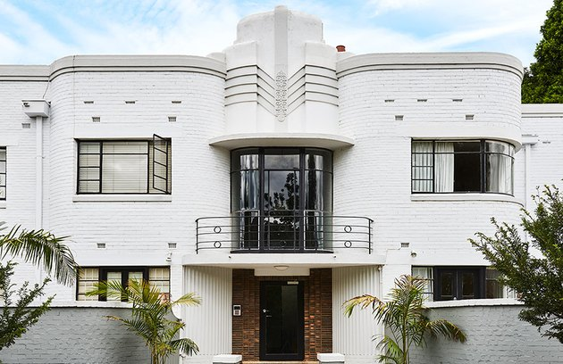 white Art Deco exterior home styles with curved balcony