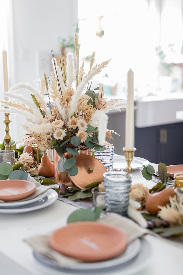 Textured fall centerpiece with pampas grass in copper vase