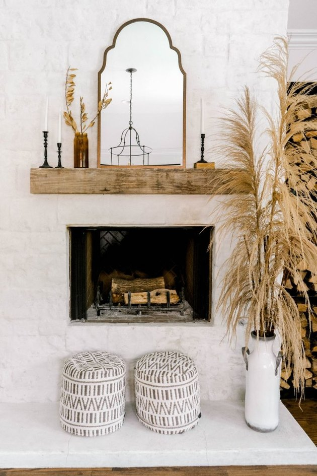 Bohemian fall decor idea for living room with pampas grass and patterned poufs