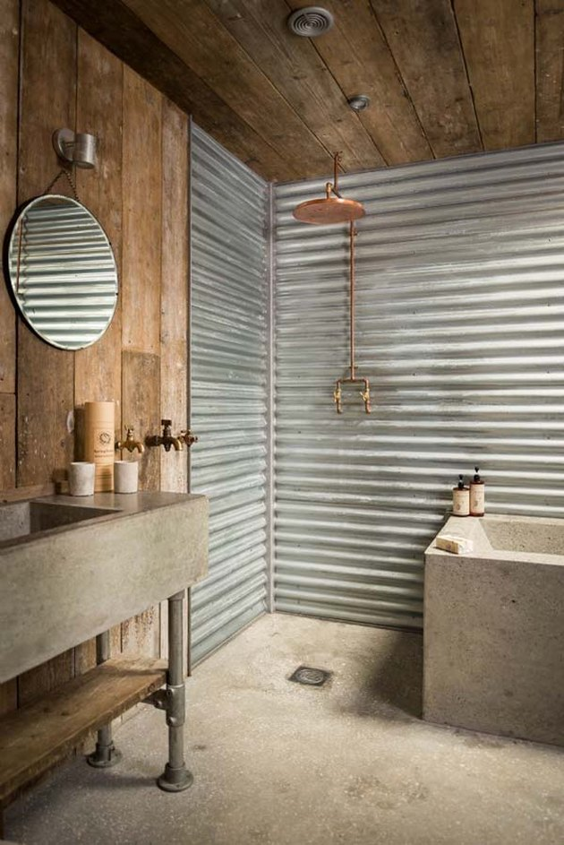 Reclaimed wood and concrete combined make this rustic bathroom utterly unique.