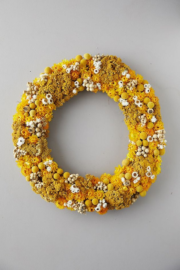 yellow fall wreath made with yellow flowers