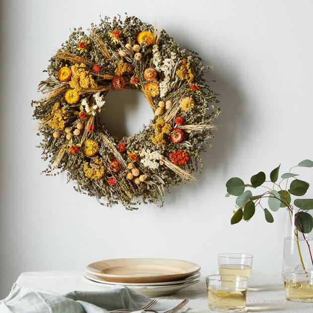 fall wreath made with marigolds and dried flowers