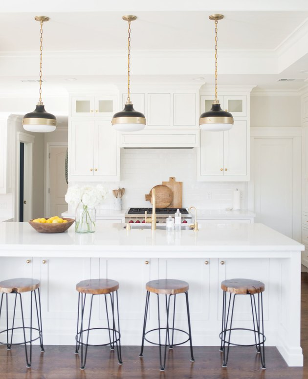 Modern coastal kitchen ideas in white kitchen three brass and black pendant lights