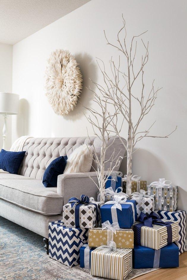 coastal living room at Christmas with white birch coastal Christmas tree