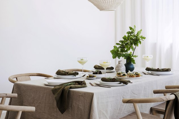 dining table with neutral linens and place settings