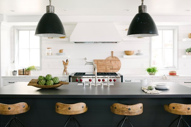 Modern coastal kitchen ideas with black island and wood bar stools