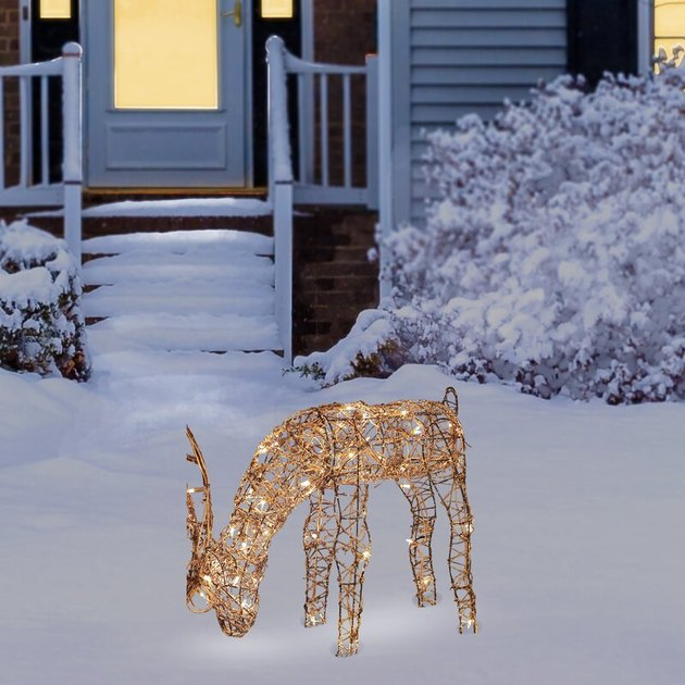 exterior Christmas decorations with Light up reindeer on snowy front yard
