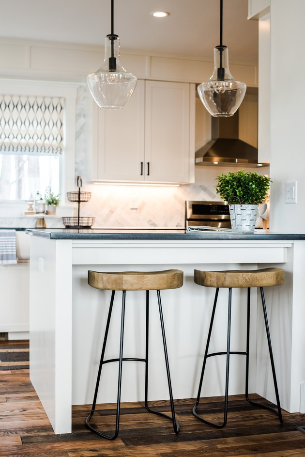 Coastal kitchen ideas in small kitchen with two wood bar stools