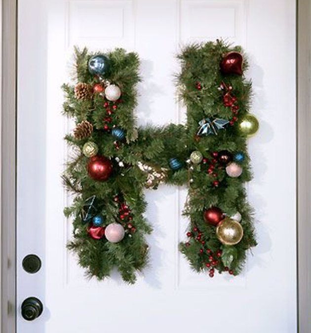 Christmas Door Decorations with H-shaped door wreath with Christmas ornaments.