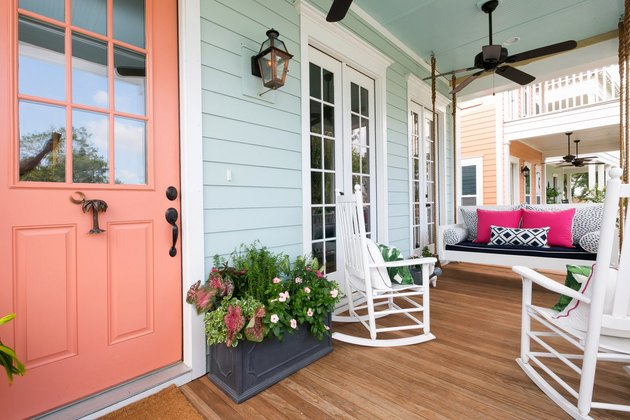 Seafoam green exterior house paint with front porch decor and salmon front door