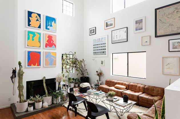 Living room with artwork and high ceilings