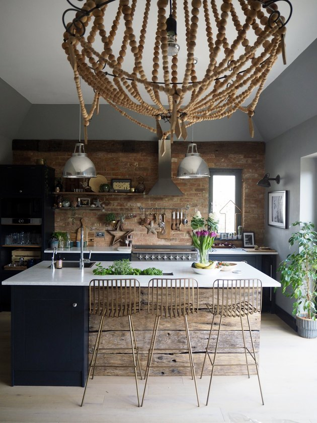 Industrial kitchen style with exposed brick wall and stainless steel lights