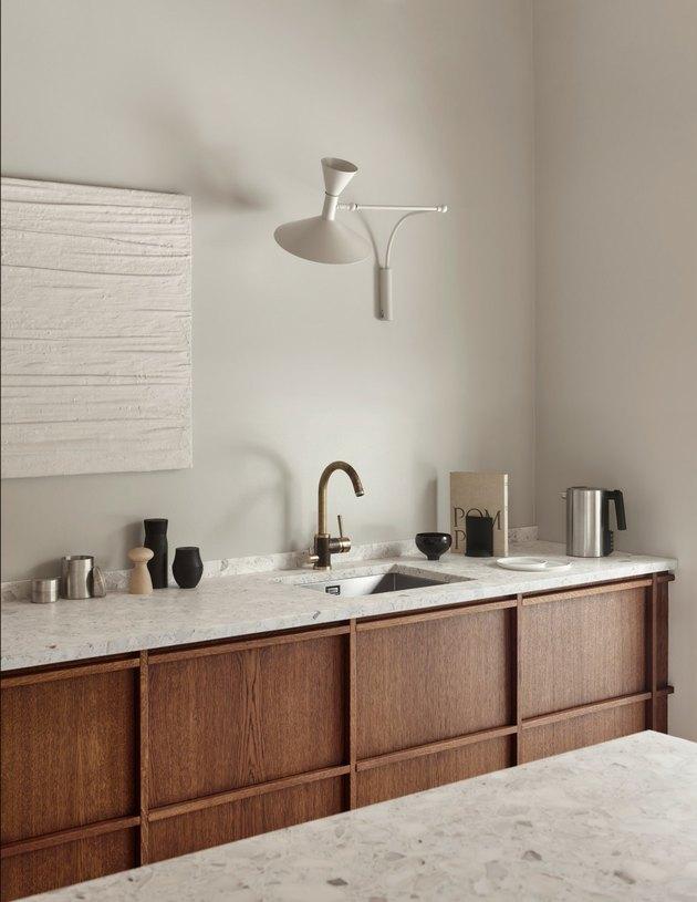 Minimalist kitchen style with geometric light and kitchen essentials