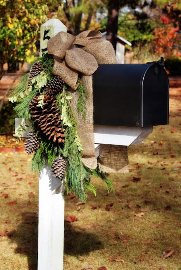 exterior Christmas decorations with Black mailbox with pine cone and greenery holiday decor.