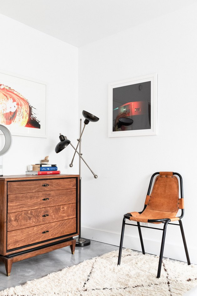 Dresser and leather chair in bedroom