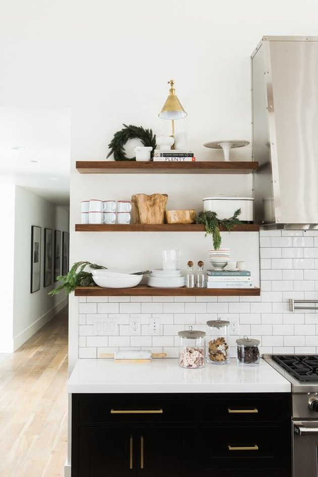 Christmas wreath and decor on open kitchen shelving by Studio McGee