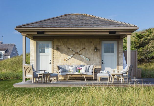 Wood-finish tan shake siding exterior beach house colors with outdoor sitting area