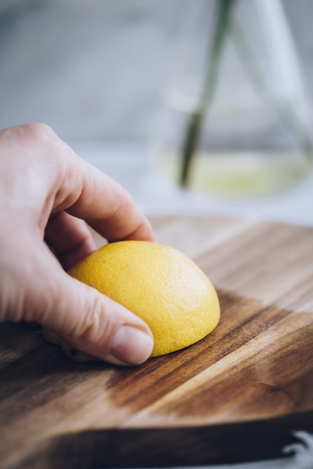 Cleaning a wood cutting board with lemon