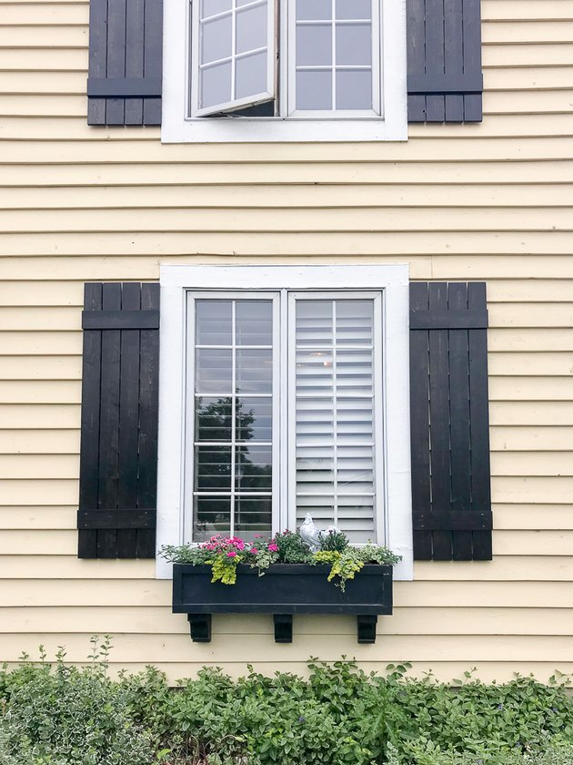 Black board and batten exterior shutter style on traditional Craftsman home