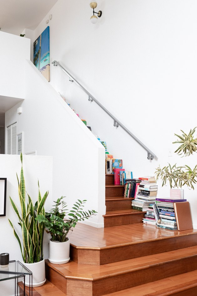 Stairs with books and plants