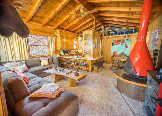 Rustic cabin with red Swedish fireplace