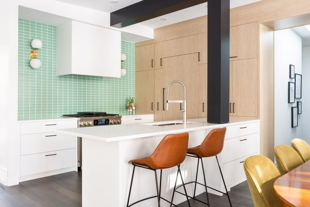 mint green kitchen backsplash and midcentury wall sconces