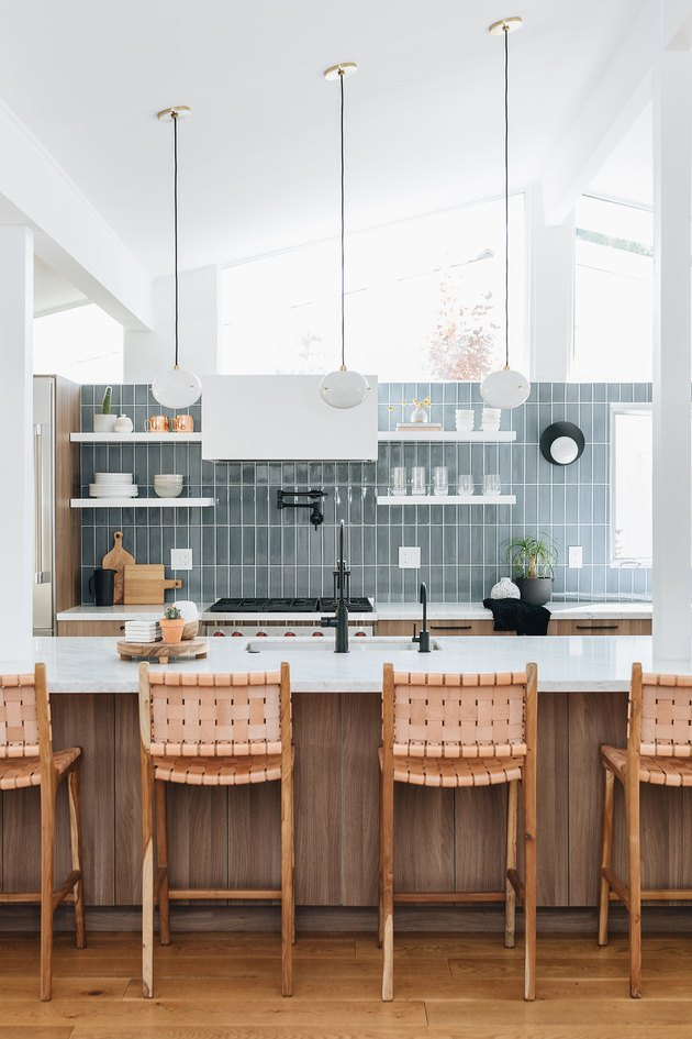 midcentury kitchen lighting idea with A-frame architecture and blue tile backsplash