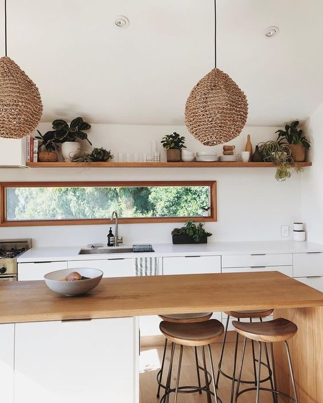 kitchen island lighting idea with woven bohemian pendant lights and wood waterfall countertop