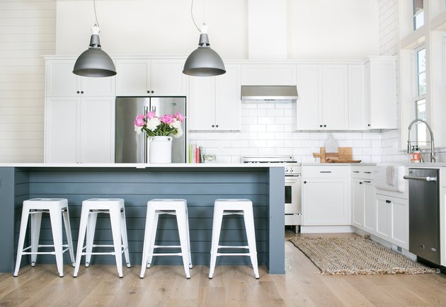 kitchen island lighting idea with factory style pendants and blue island