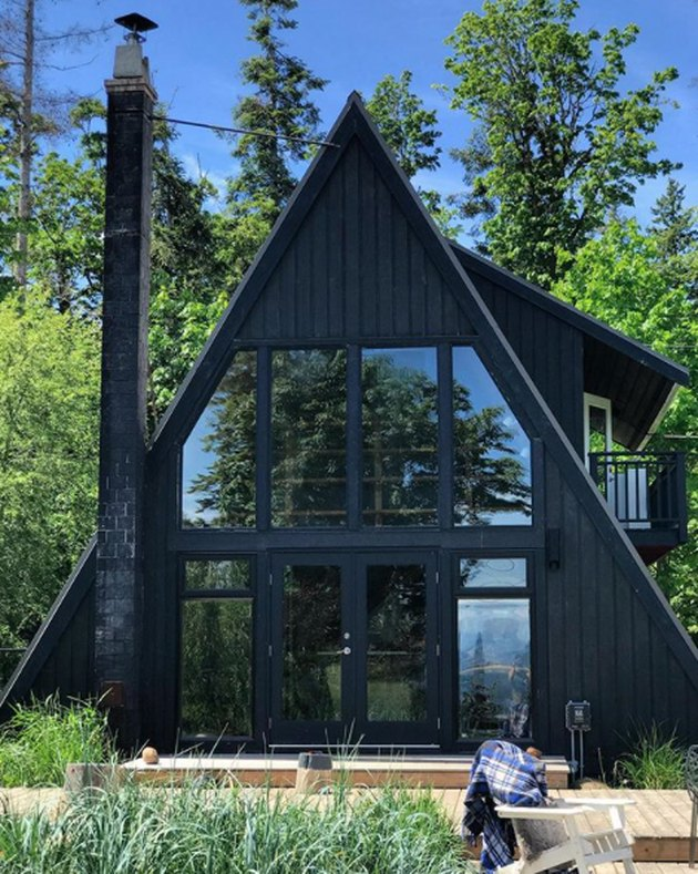 black A-frame with window facade