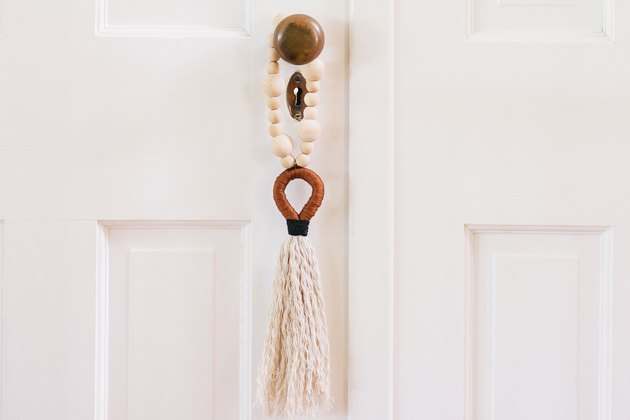 Bohemian door tassel in neutral colors.