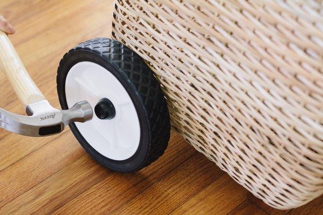 Hammering hubcap onto rod