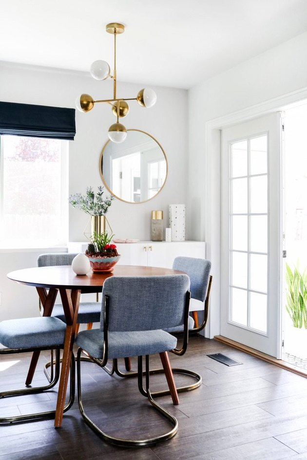 white dining room with midcentury decor