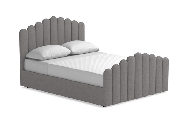 gray bed with sculptural headboard and footboard