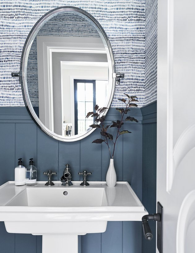 traditional vitreous china pedestal bathroom sink in front of blue walls