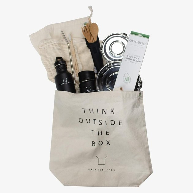 "Tote bag with ""think outside the box"" in text and a variety of eco-friendly items inside"