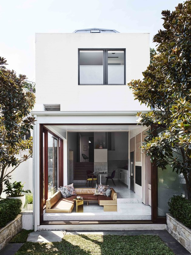 white home exterior with glass doors