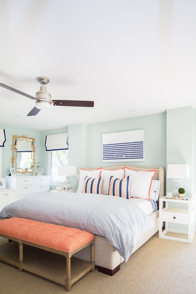 Classic coastal bedding idea with striped artwork and striped bedding