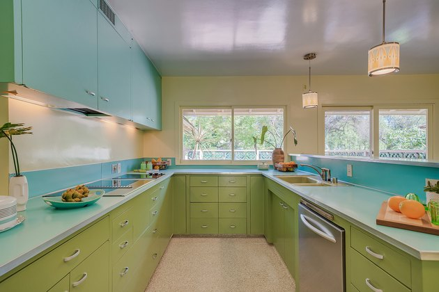 kitchen with green and blue cabinets
