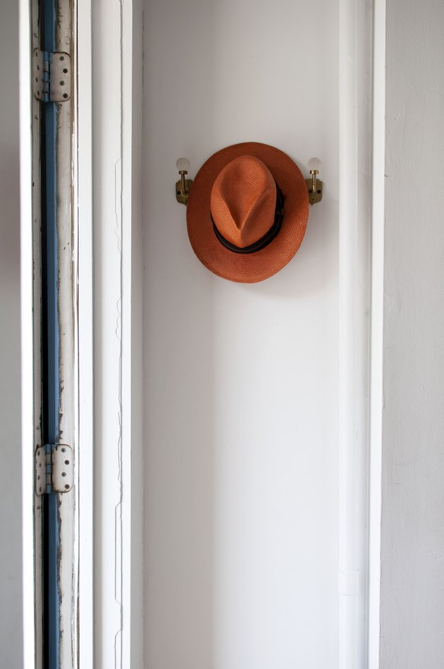 hat hung on wall