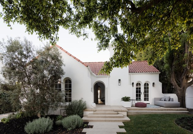 white home exterior with spanish tile roof