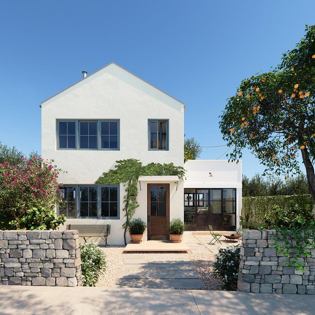 white home exterior with wood door and blue casement window trim