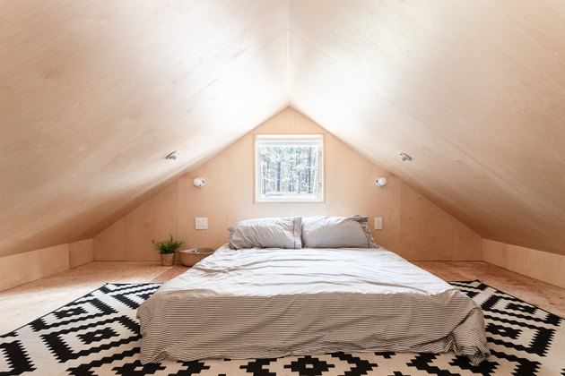 room with angled wood ceiling