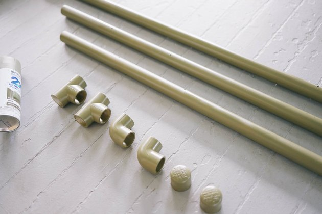 PVC pipes, c0nnectors and caps spray painted olive green