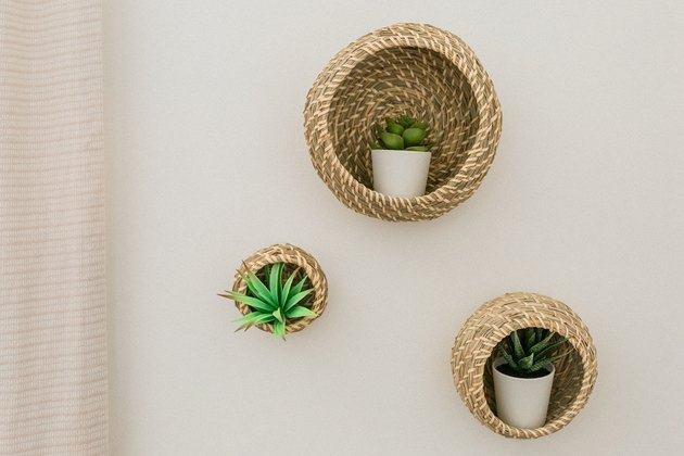 Basket wall planters with succulents.