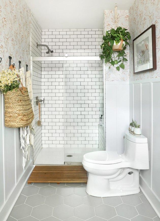 A one-piece type of toilet in a white modern farmhouse bathroom