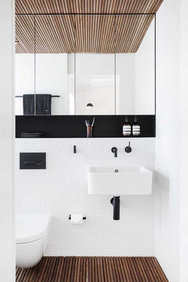 monochrome color palette with wall-mounted bathroom sink